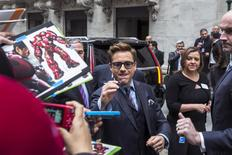 Actors Robert Downey Jr. signs autographs as he arrives to promote the film Avengers: Age of Ultron at the New York Stock Exchange April 27, 2015. REUTERS/Lucas Jackson