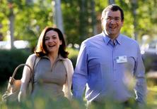 In this file photo, Sheryl Sandberg, Chief Operating Officer (COO) of Facebook, arrives with her husband David Goldberg, CEO of SurveyMonkey, for the first day of the Allen and Co. media conference in Sun Valley, Idaho July 9, 2014. REUTERS/Rick Wilking