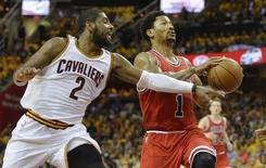 Chicago Bulls guard Derrick Rose (1) drives against Cleveland Cavaliers guard Kyrie Irving (2) in the first quarter in game one of the second round of the NBA Playoffs at Quicken Loans Arena. Mandatory Credit: David Richard-USA TODAY Sports
