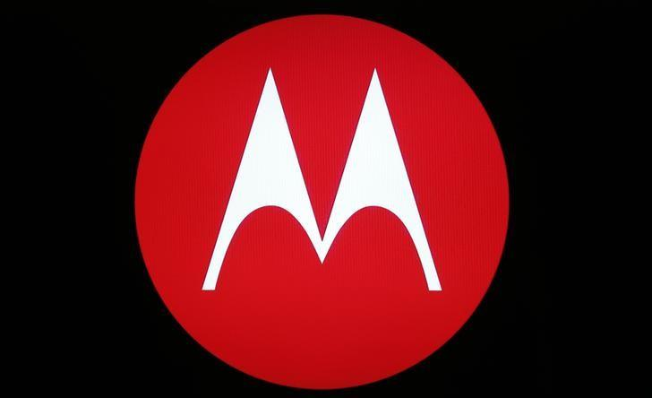 A Motorola Mobility logo is seen on a screen at the public unveiling of their global headquarters in Chicago, Illinois, April 22, 2014. REUTERS/Jim Young