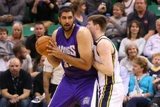 Apr 8, 2015; Salt Lake City, UT, USA; Sacramento Kings center Sim Bhullar (32) dribbles the ball as Utah Jazz forward Jack Cooley (45) defends during the fourth quarter at EnergySolutions Arena. Utah Jazz on the game 103-91. Mandatory Credit: Chris Nicoll-USA TODAY Sports