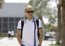 Williams Formula One driver Valtteri Bottas of Finland  arrives ahead of Bahrain's F1 Grand Prix at Bahrain International Circuit south of Manama, April 16, 2015. REUTERS/Hamad I Mohammed/Files