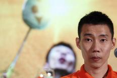 Malaysia's Lee Chong Wei looks on during a news conference in Bangkok November 21, 2014. REUTERS/Athit Perawongmetha