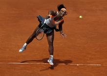 Serena Williams of the U.S. serves the ball to Petra Kvitova of the Czech Republic during her semi-final match at the Madrid Open tennis tournament in Madrid, Spain, May 8, 2015. REUTERS/Andrea Comas