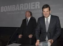 Bombardier Inc.'s Pierre Beaudoin (R), executive chairman of the board, and Alain Bellemare, president and chief executive officer, and arrive for the company's annual general meeting in Montreal, May 7, 2015. REUTERS/Christinne Muschi