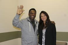 Brazilian soccer legend Pele (L) waves with his wife Marcia Cibele Aoki at the Albert Einstein Hospital in Sao Paulo in this May 9, 2015 handout photograph from his family, courtesy of the hospital.  REUTERS/Picture courtesy of family/Handout via Reuters