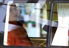 Thailand's King Bhumibol Adulyadej sits in a vehicle as he leaves Siriraj Hospital in Bangkok, Thailand, May 10, 2015.   REUTERS/Chaiwat Subprasom