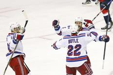 New York Rangers defenseman Dan Boyle (22) celebrates with Rangers left wing Tanner Glass (15) after scoring the eventual game-winning goal against the Washington Capitals in the third period in game six of the second round of the 2015 Stanley Cup Playoffs at Verizon Center. Mandatory Credit: Geoff Burke-USA TODAY Sports
