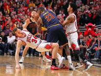 May 10, 2015; Chicago, IL, USA; Chicago Bulls forward Mike Dunleavy (34) is fouled by Cleveland Cavaliers forward LeBron James (23) in the second half of game four of the second round of the NBA Playoffs at the United Center. Dennis Wierzbicki-USA TODAY Sports
