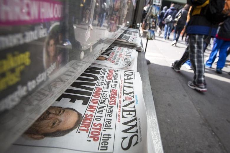 Copies of the New York Daily News are displayed on a newsstand in New York's Times Square March 31, 2015.  REUTERS/Brendan McDermid