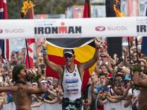 File photo of professional male triathlete Frederik Van Lierde of Belgium celebrates after winning the Ironman World Championship in Kailua-Kona, Hawaii, October 12, 2013. REUTERS/Hugh Gentry