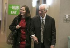 NHL legend Gordie Howe walks with a friend while making his way to a dinner with other NHL legends like Wayne Gretzky and Bobby Hull to honour his legacy in Saskatoon, Saskatchewan February 6, 2015. REUTERS/David Stobbe