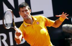 Novak Djokovic of Serbia returns the ball to Nicolas Almagro of Spain during their match at the Rome Open tennis tournament in Rome, Italy May 12, 2015. REUTERS/Tony Gentile