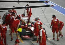 Formula One driver Felipe Massa of Brazil stops for a refuel during the second practice session at the Sepang International Circuit in this file photo taken on April 3, 2009. REUTERS/David Loh