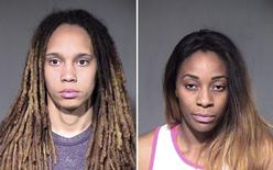 Women's National  Basketball Association (WNBA) players Brittney Griner (L) of the Phoenix Mercury and her fiancee Glory Johnson of the Tulsa Shock, are shown in this combo of police booking photos provided April 23, 2015. REUTERS/Maricopa County Sheriff's Office/Handout via Reuters