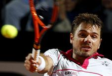Stan Wawrinka of Switzerland returns the ball to Rafael Nadal of Spain during their men's quarter-final match at the Rome Open tennis tournament in Rome, Italy, May 15, 2015. REUTERS/Stefano Rellandini