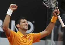 Novak Djokovic of Serbia celebrates after winning his semi-final match against David Ferrer of Spain at the Rome Open tennis tournament in Rome, Italy, May 16, 2015. REUTERS/Stefano Rellandini