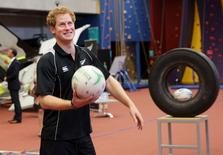 Britain's Prince Harry pulls a face while playing with a netball at the AUT Millennium Institute in Mairangi Bay, Auckland, New Zealand, May 16, 2015.   REUTERS/Doug Sherring/Pool
