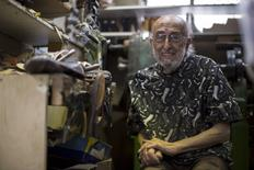 Owner Arturo Azinian poses for a portrait in his shoe repair shop in Beverly Hills, California April 24, 2015.  REUTERS/Mario Anzouni