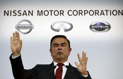 Nissan Motor Co's President and Chief Executive Officer Carlos Ghosn gestures as he speaks at a news conference at its headquarters in Yokohama, south of Tokyo, May 13, 2015. REUTERS/Toru Hanai