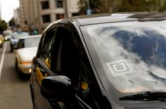 The Uber logo is seen on a vehicle near Union Square in San Francisco, California May 7, 2015.  REUTERS/Robert Galbraith