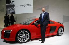 Audi Chief Executive Officer Rupert Stadler poses with an Audi R8 sports car at the annual news conference in the Bavarian city of Ingolstadt March 10, 2015.           REUTERS/Michael Dalder