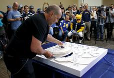 Architect Dam Meis presents his model as San Diego's Citizens Stadium Advisory Group unveils their plan for building a new $1.1 billion NFL football stadium in San Diego, California May 18, 2015. REUTERS/Mike Blake