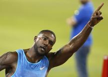 Justin Gatlin from the U.S. reacts after winning the men's 100 meters event during the Diamond League meeting in Doha, Qatar May 15, 2015.  REUTERS/AK Bijuraj