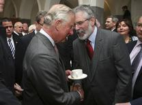 Britain's Prince Charles (L) shakes hands with Gerry Adams at the National University of Ireland in Galway, Ireland May 19, 2015. REUTERS/Brian Lawless/pool