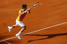 Novak Djokovic of Serbia returns the ball to Roger Federer of Switzerland during their final match at the Rome Open tennis tournament in Rome, Italy, May 17, 2015. REUTERS/Tony Gentile