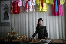 A woman stands in a gift shop in central Rason city, part of the special economic zone northeast of Pyongyang, in this August 30, 2011 file photo.  REUTERS/Carlos Barria/Files