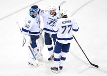 May 24, 2015; New York, NY, USA; Tampa Bay Lightning goalie Ben Bishop (30), center Steven Stamkos (91) and defenseman Victor Hedman (77) celebrate a win against the New York Rangers game five of the Eastern Conference Final of the 2015 Stanley Cup Playoffs at Madison Square Garden. The Lightning defeated the Rangers, 2-0. Mandatory Credit: Eric Hartline-USA TODAY Sports