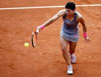 Carla Suarez Navarro of Spain plays a shot to Monica Niculescu of Romania during their women's singles match at the French Open tennis tournament at the Roland Garros stadium in Paris, France, May 25, 2015.       REUTERS/Vincent Kessler