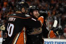 Anaheim Ducks right wing Corey Perry (10) congratulates left wing Matt Beleskey (right) for scoring the game-winning goal against the Chicago Blackhawks during the overtime period in game five of the Western Conference Final of the 2015 Stanley Cup Playoffs at Honda Center. Mandatory Credit: Gary A. Vasquez-USA TODAY Sports