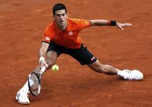 Novak Djokovic of Serbia plays a shot to Jarkko Nieminen of Finland during their men's singles match at the French Open tennis tournament at the Roland Garros stadium in Paris, France, May 26, 2015.                  REUTERS/Pascal Rossignol