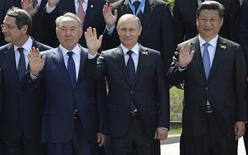 Presidents Nicos Anastasiades of Cyprus (L-R), Vladimir Putin of Russia, Nursultan Nazarbayev of Kazakhstan and Xi Jinping of China pose for a picture in the Alexander Garden on the Victory Day in central Moscow, Russia, May 9, 2015. Russia marks the 70th anniversary of the end of World War Two in Europe on Saturday with a military parade, showcasing new military hardware at a time when relations with the West have hit lows not seen since the Cold War.     ATTENTION EDITORS - THIS IMAGE HAS BEEN SUPPLIED BY A THIRD PARTY. IT IS DISTRIBUTED, EXACTLY AS RECEIVED BY REUTERS, AS A SERVICE TO CLIENTS