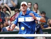 John Isner of the U.S. plays a shot to Andreas Seppi of Italy during their men's singles match at the French Open tennis tournament at the Roland Garros stadium in Paris, France, May 26, 2015. REUTERS/Vincent Kessler