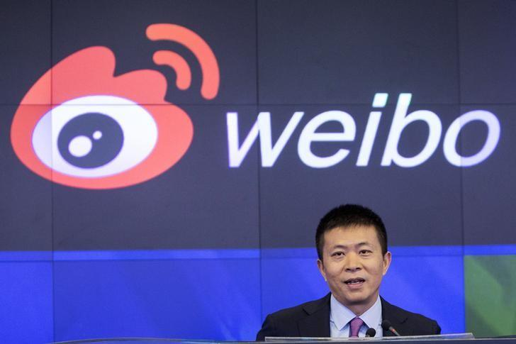 Weibo Corporation Chairman Charles Chao speaks during a visit to the NASDAQ MarketSite in Times Square in celebration of Weibo's initial public offering (IPO) on The NASDAQ Stock Market in New York April 17, 2014. REUTERS/Andrew Kelly