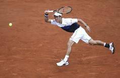 Kei Nishikori of Japan plays a shot to Thomaz Bellucci of Brazil during their men's singles match at the French Open tennis tournament at the Roland Garros stadium in Paris, France, May 27, 2015.                REUTERS/Gonzalo Fuentes