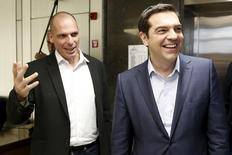 Greek Finance Minister Yanis Varoufakis (L) welcomes Prime Minister Alexis Tsipras for a meeting at the ministry in Athens, Greece May 27, 2015.  REUTERS/Alkis Konstantinidis