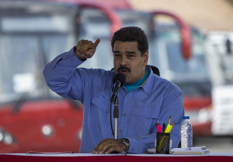 Venezuela's President Nicolas Maduro speaks during the opening ceremony of a new avenue and inauguration of a public transportation route with Yutong brand buses in Los Teques, Venezuela May 16, 2015. REUTERS/Marco Bello - RTX1D9XA