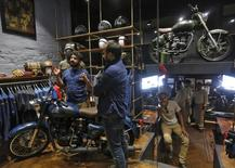 Eicher Motors Ltd. Chief Executive Officer Siddhartha Lal (L) speaks as the President of Royal Enfield, Rudratej Singh (C), watches during the launch of their limited edition motorcycle at Royal Enfield's new flagship store in New Delhi, India, May 28, 2015. REUTERS/Adnan Abidi