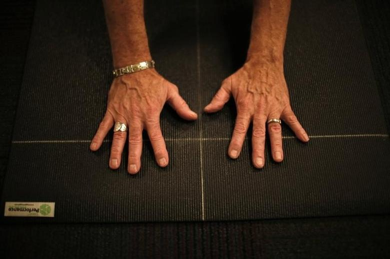 A senior does yoga in Sun City, Arizona, January 7, 2013. REUTERS/Lucy Nicholson