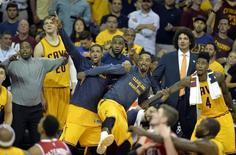 Cleveland Cavaliers center Tristan Thompson (13), guard J.R. Smith (5), forward LeBron James (23) and guard Iman Shumpert (4) react from the bench during the fourth quarter against the Atlanta Hawks in game four of the Eastern Conference Finals of the NBA Playoffs at Quicken Loans Arena. May 26, 2015; Cleveland, OH, USA;  David Richard-USA TODAY Sports