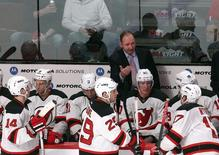 Peter DeBoer talks to the players at Bell Centre; Jan 14, 2014; Montreal, Quebec, CAN; Jean-Yves Ahern-USA TODAY Sports