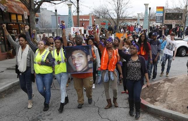 People protest over a police shooting of a naked man named Anthony Hill in Decatur, Georgia March 11, 2015.  REUTERS/Tami Chappell