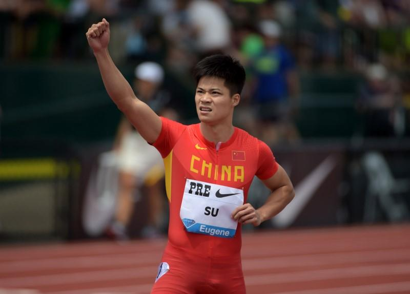 May 30, 2015; Eugene, OR, USA; Bingtian Su (CHN) celebrates after finishing third in the 100m in a national record 9.99 during the 41st Prefontaine Classic ...
