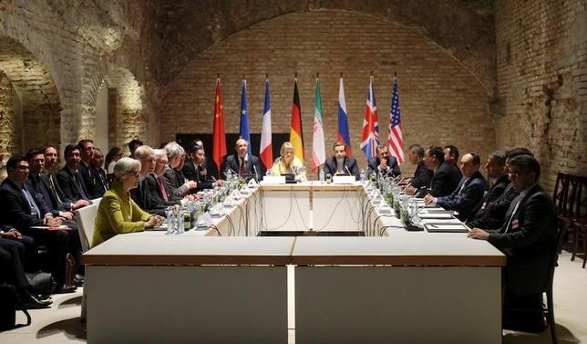 Negotiators of Iran and six world powers face each other at a table in the historic basement of Palais Coburg hotel in Vienna April 24, 2015.  REUTERS/Heinz-Peter Bader