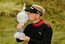 Denmark's Soren Kjeldsen celebrates his win with the trophy. The Irish Open - The Royal County Down Golf Club, Newcastle, County Down, Northern Ireland - 31/5/15. Action Images / Paul Childs