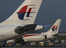 Malaysia Airlines planes sit on the tarmac at Kuala Lumpur International Airport July 21, 2014. REUTERS/Edgar Su